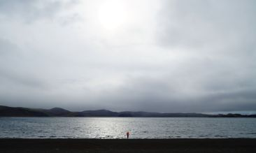 Location shot of a lake and black sands in Iceland