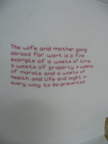 A beautifully embroidered quote from the 19thc, on the front of the apron
