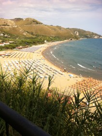 The bay at Sperlonga - look at all those overpriced sun-loungers!