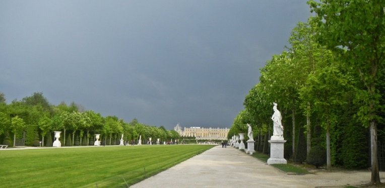 Versailles from the gardens before the rain.