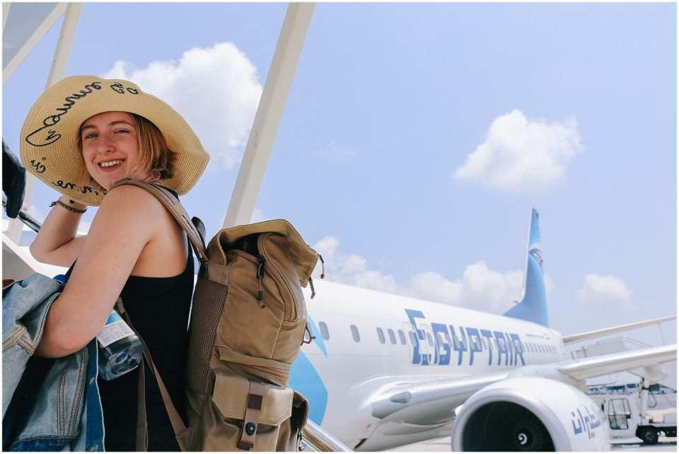 girl boarding plane to Egypt on Egypt Air plane