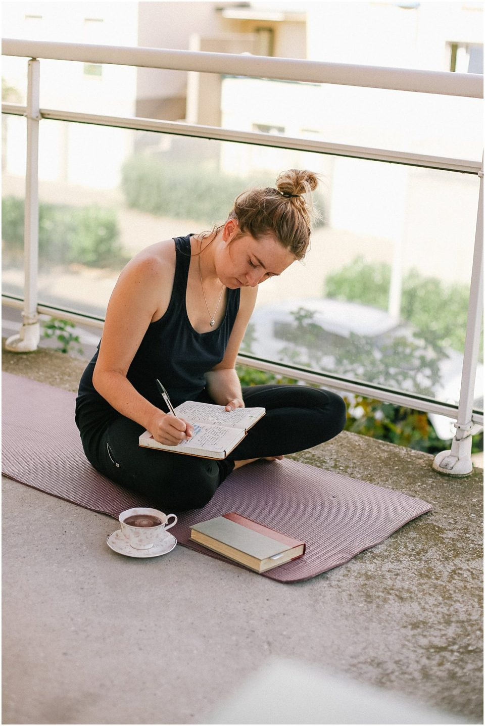gratitude journaling on a yoga mat with a peaceful morning routine Helena Woods