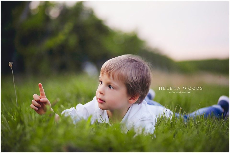 boy with flower in the fields with connecticut family photographer Helena Woods