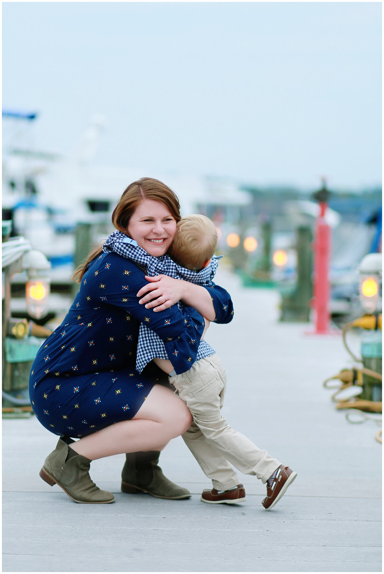 Old Town Alexandria family photographer photographs mother and son at waterfront park harbor