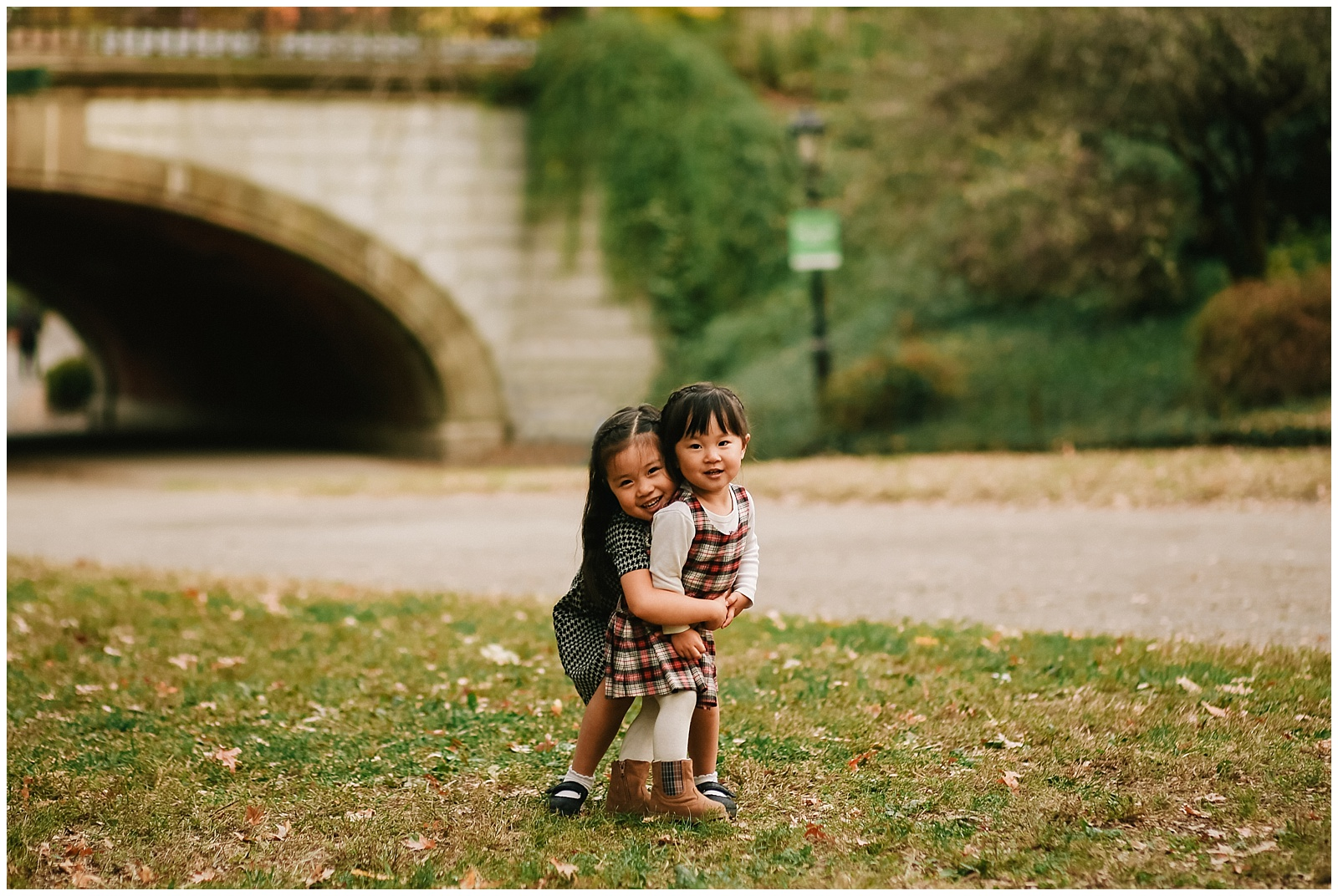 sisters hugging in central park for nyc family kids photographer Helena Woods