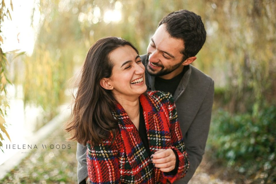 couple laughing and cuddling with Helena Woods Photography