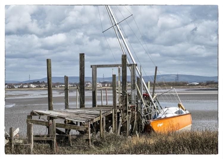 orange boat and jetty