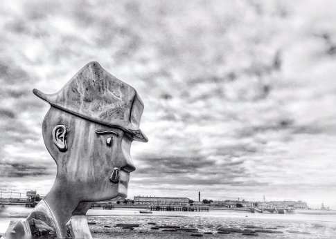 A Man with a Dog and a Pipe stainless steel statue of Lowry at Knott End