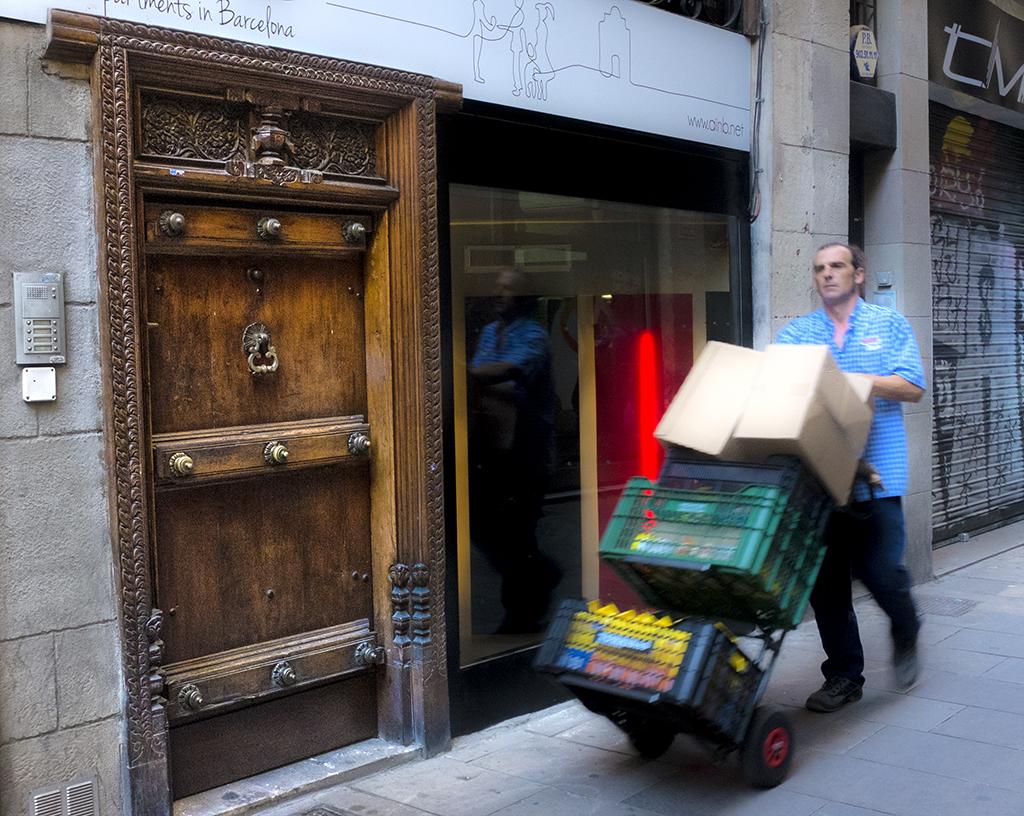 Delivery Man Gothic Quarter Barcelona doors