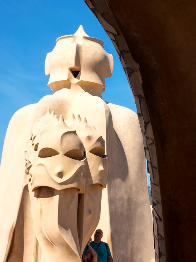 La Pedrera: Archway roof Gaudi Chimney-pots faces Barcelona
