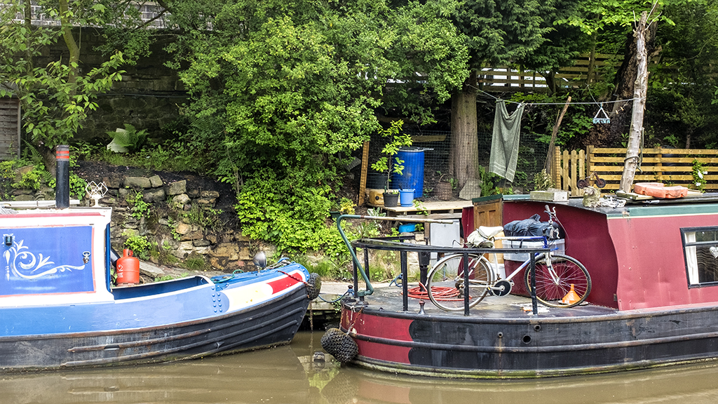 Bike on board narrowboat canal Hebden Bridge