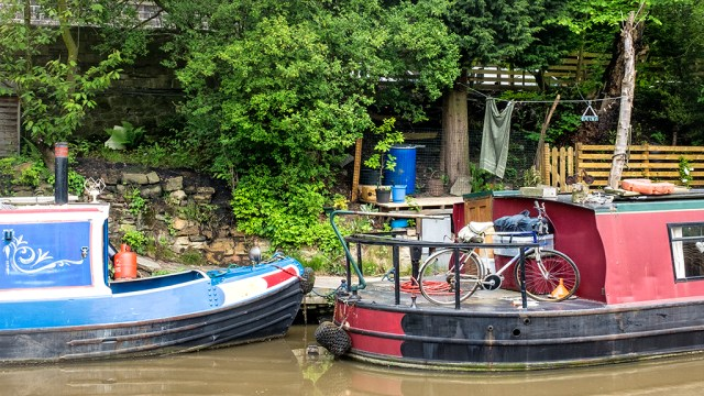 Bike on board narrowboat canal Hebden Bridge