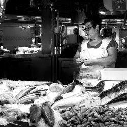 filleting fish market LaBoqueria stall Barcelona monochrome Black & White