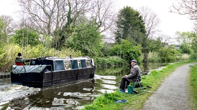 Narrowboat boat fisherman towpath Lancaster Canal Preston