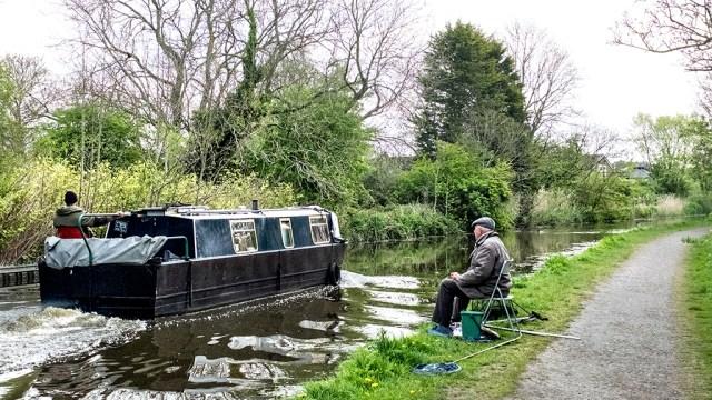 Narrowboat boat fisherman towpath Lancaster Canal Preston