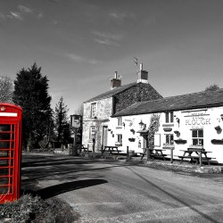 LOCAL PUB: The Plough at Eaves shadows telephone kiosk monochrome Black & White