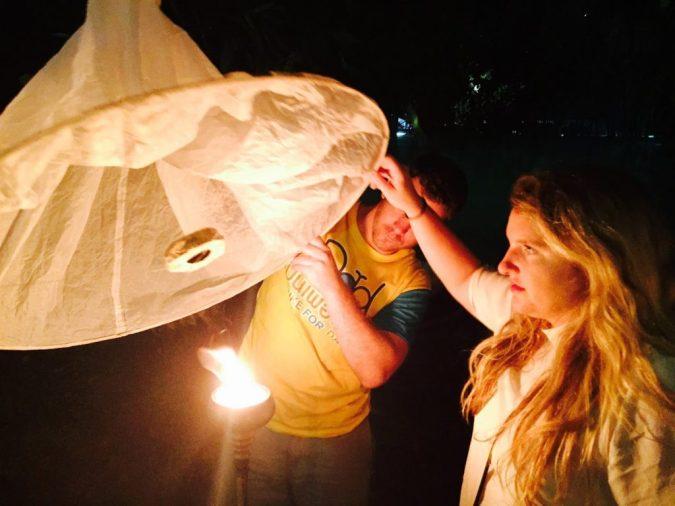lighting the lantern at Yee Peng Lantern Festival