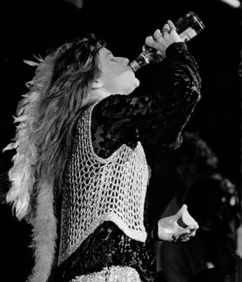 Janis drinking on stage