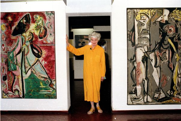 Peggy Guggenheim with Jackson Pollock paintings