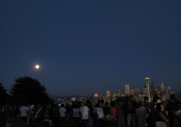 Space Needle blue moon, and crowd