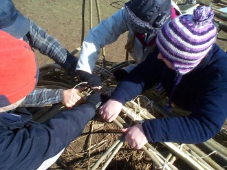 All hands to the pump to get those last thick willow stems to stay in place!