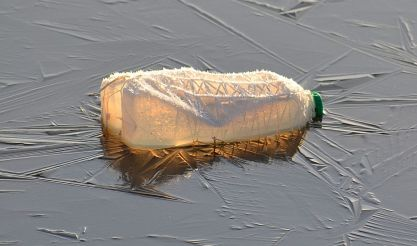 plastic milk bottle on frozen lake 1