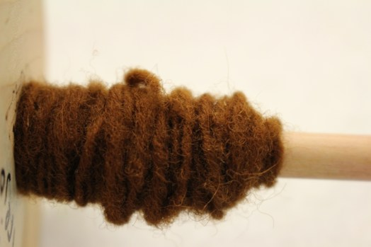Henna Wool on Spindle, 2015