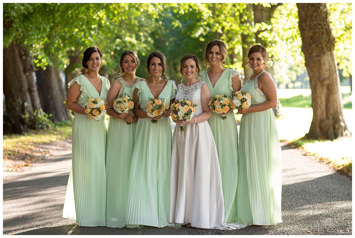 Bride and bridesmaids portrait at Mottram Hall