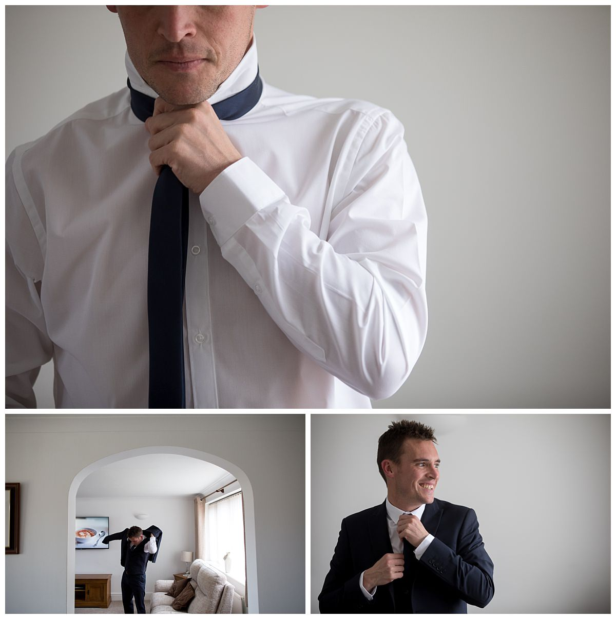 Groom putting on his tie and jacket