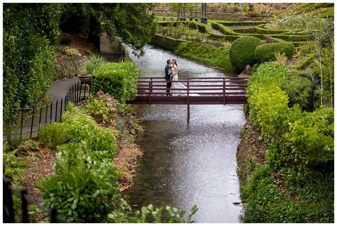 Bride and groom stood on a bridge at The Raithwaite Estate