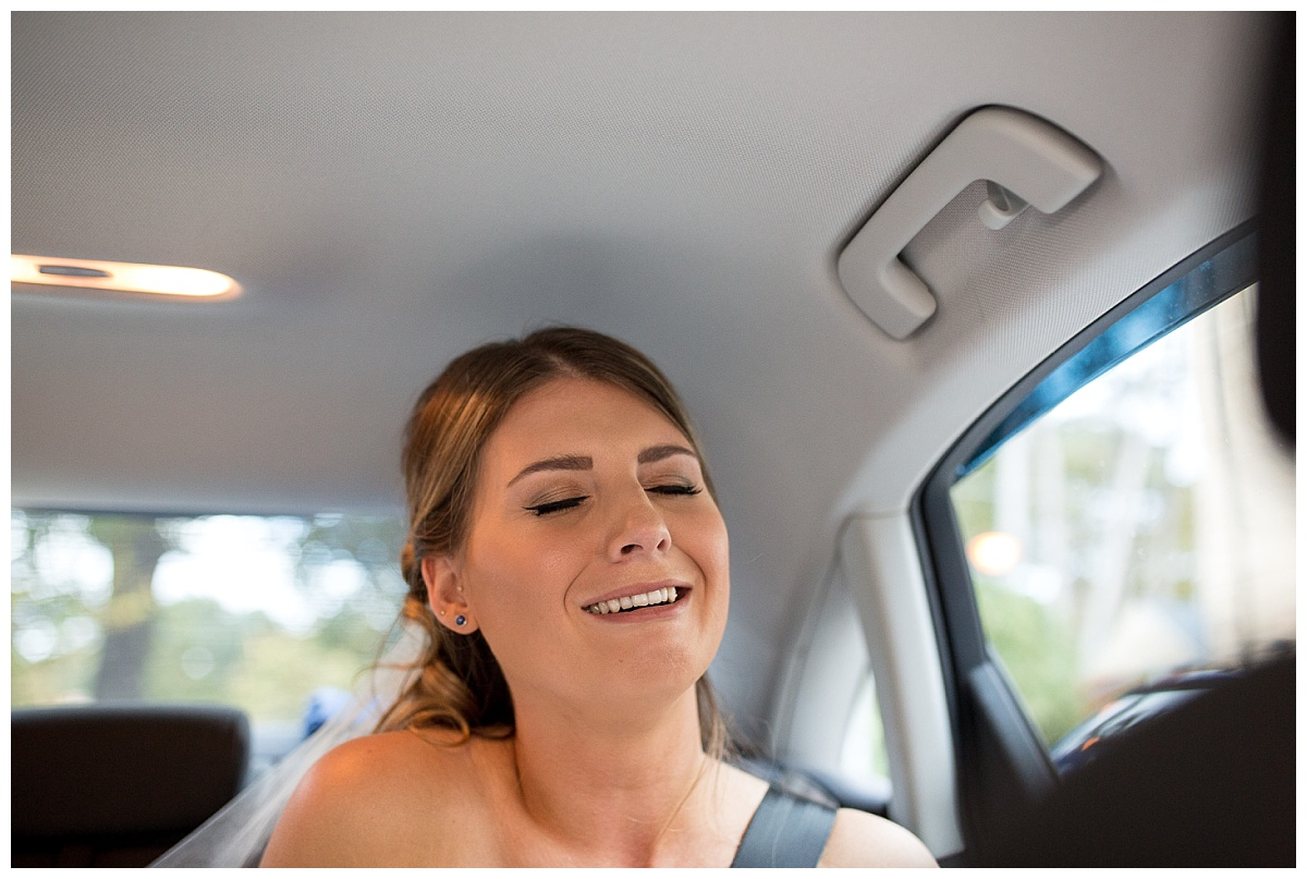 Bride in the back of the wedding car