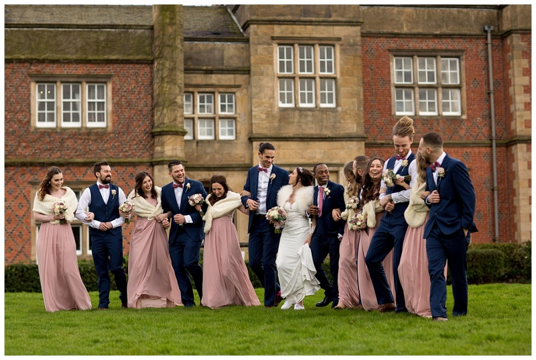 Bridal Party walking at De Vere Cranage Estate Wedding