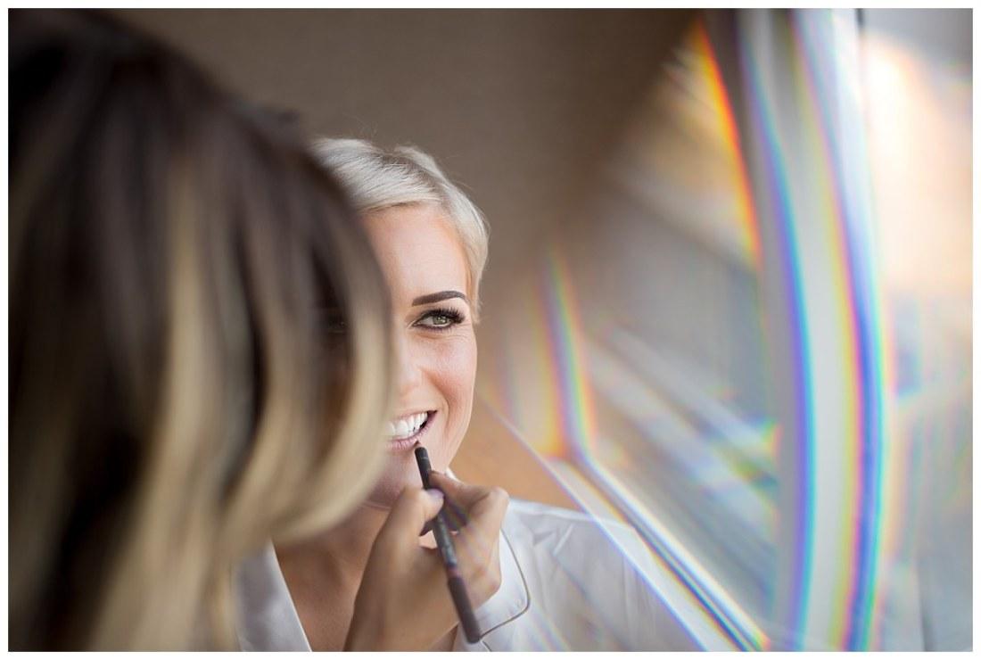Bride having lipstick applied