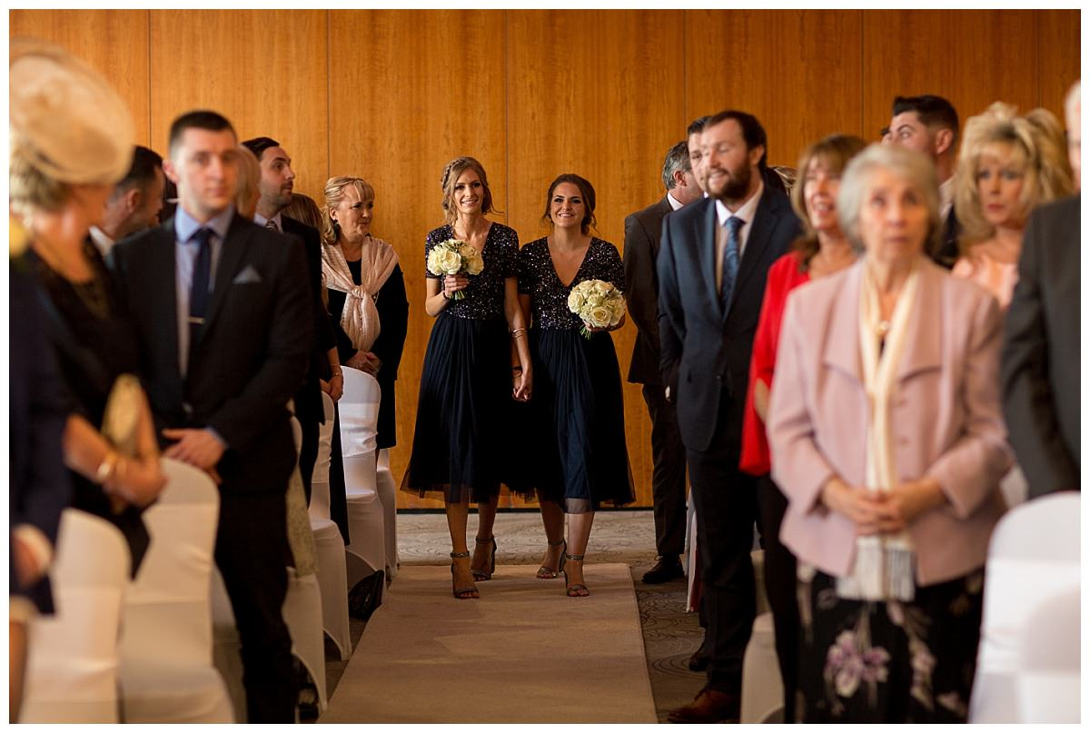 Cheshire bridesmaids walking down the aisle