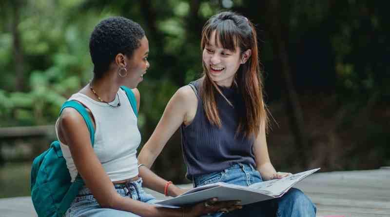 multiethnic students with opened copybook