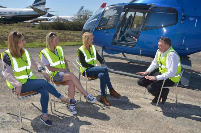 Helicopter pilot briefing tourists