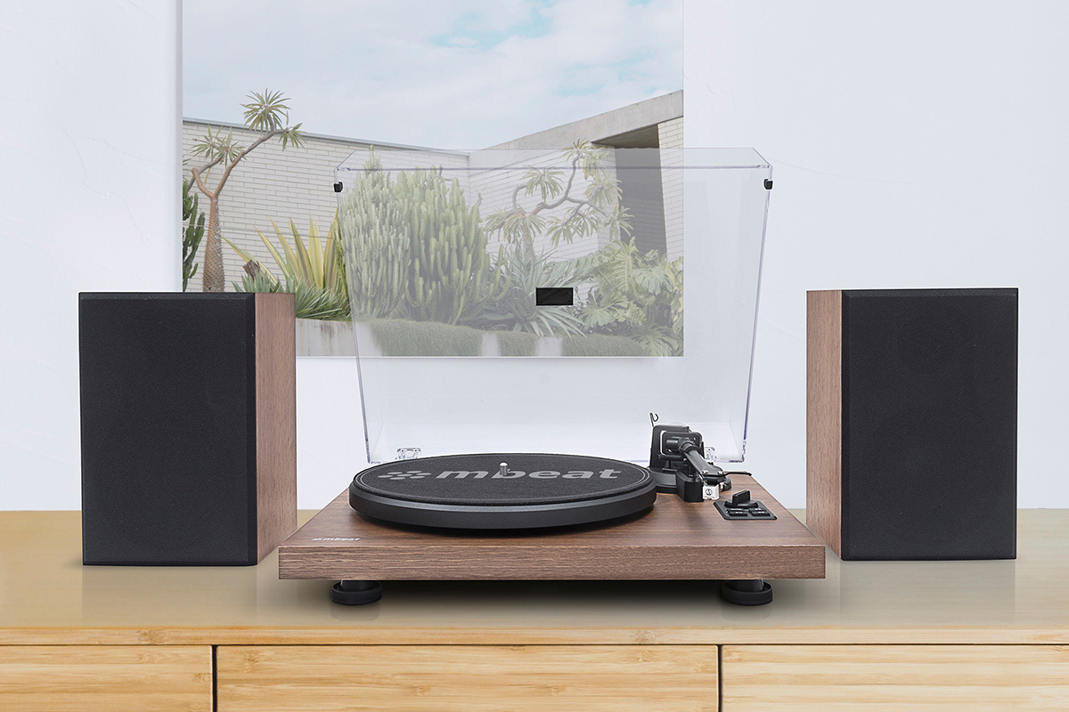 Switch between vinyl records and music from your phone with ease.
