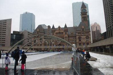 Ice skating in front of Toronto City Hall. The beautiful building in the background is the old city hall