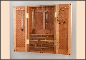 Cherry jewelry cabinet with bocote drawer fronts, necklace spinners