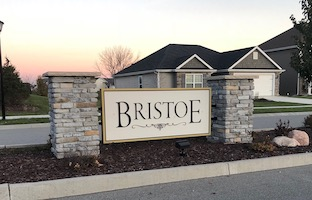 A picture of the entrance sign for Bristoe Communities
