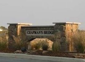 A picture of the entrance sign for Chapman's Bridge Communities