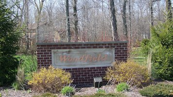 A picture of the entrance sign for Woodfield Communities