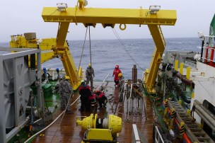 9-meter gravity core as it is recovered and resting on the back deck