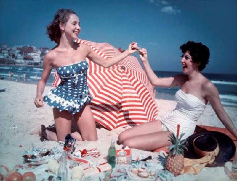 2 girls celebrate Christmas lunch on Bondi Beach in 1959 on Bondi Beach, 1959