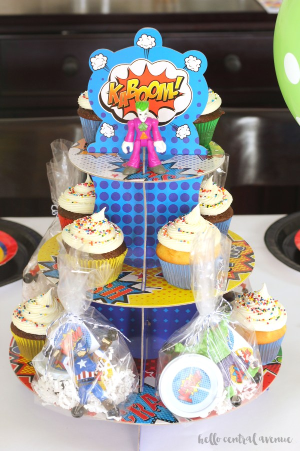How to throw an inexpensive and easy superhero party. Bright colors and free printables fill this party with fun.