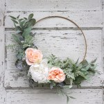 Make an easy spring hoop wreath using greens and faux flowers. Just tie and glue the stems in place to create a beautiful wreath for any time of year.