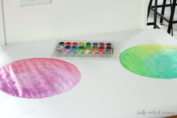 Use watercolor paint to create DIY watercolor chargers for your Easter or spring table!