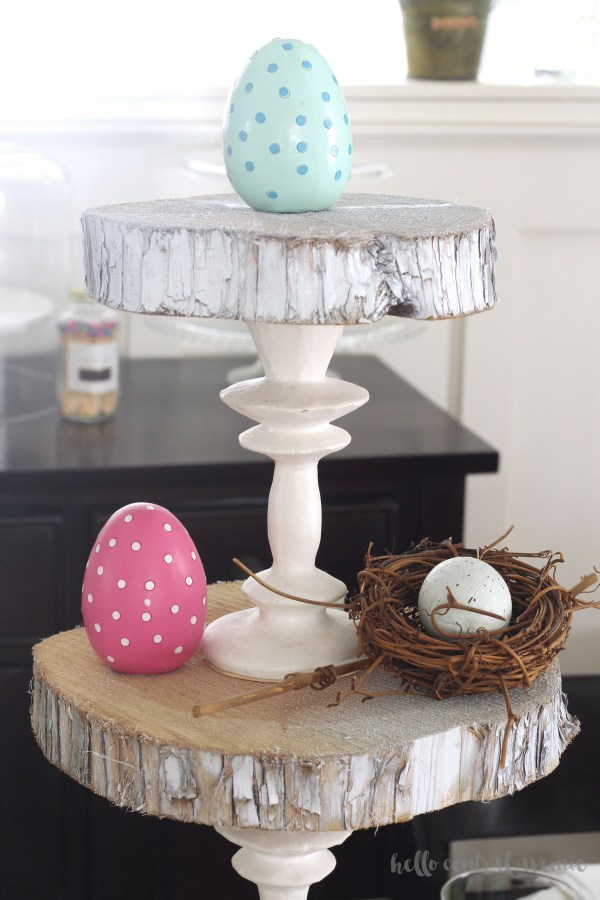 Create a gorgeous three-tiered stand out of wooden slabs and candlestick holders. It's super easy!