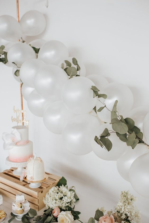 Here are five easy ways to make a balloon garland. Keep it simple or add some flowers and other decorations to spice it up.