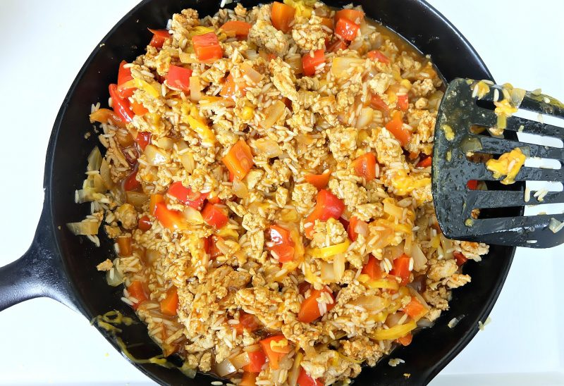 Looking for a quick and easy, one pan healthy dinner idea that will feed a crowd? This turkey and rice Mexican casserole recipe only takes 10 minutes to prep, then you pop it in the oven. Perfect for filling tacos, burritos or using as a topping for taco salad! A healthy, delicious and family friendly meal idea! #MakeItWithTurkey #Recipe #Mexican #Turkey #OnePan